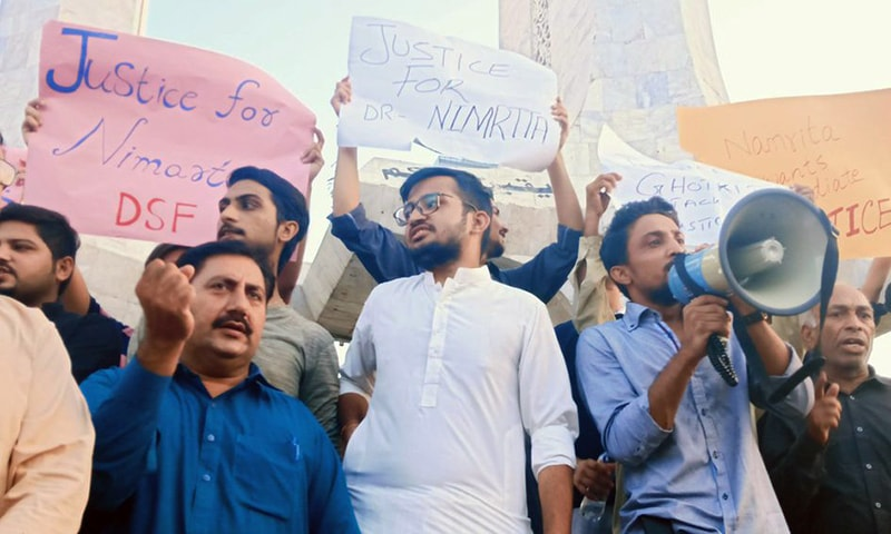 Civil society members gathered at Teen Talwar in Karachi on Wednesday to protest against the death of a medical student in Larkana. — Photo courtesy Jibran Nasir's Twitter account