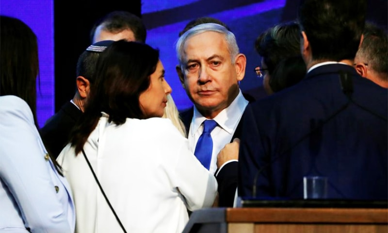 Israeli Prime Minister Benjamin Netanyahu looks on after speaking to supporters at his Likud party headquarters following the announcement of exit polls during Israel's parliamentary election in Tel Aviv. — Reuters