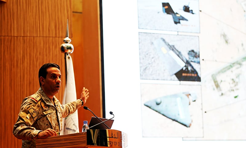 Saudi defence ministry spokesman Colonel Turki al-Malik displays on a screen drones which Saudi government says attacked an Aramco oil facility. — Reuters
