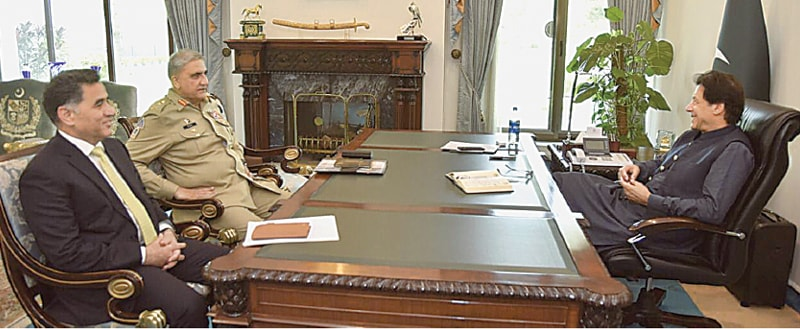ISLAMABAD: Army Chief Gen Qamar Javed Bajwa calls on Prime Minister Imran Khan at the PM House here on Wednesday. The ISI chief is also present at the meeting.