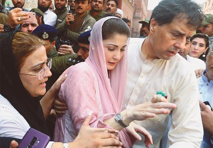RETIRED captain Mohammad Safdar escorts his wife Maryam Nawaz to an accountability court on Wednesday.—AP