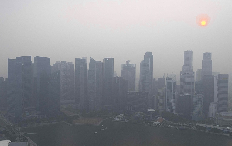 SINGAPORE: Buildings pictured after a haze blanketed the skyline on Wednesday.—AFP