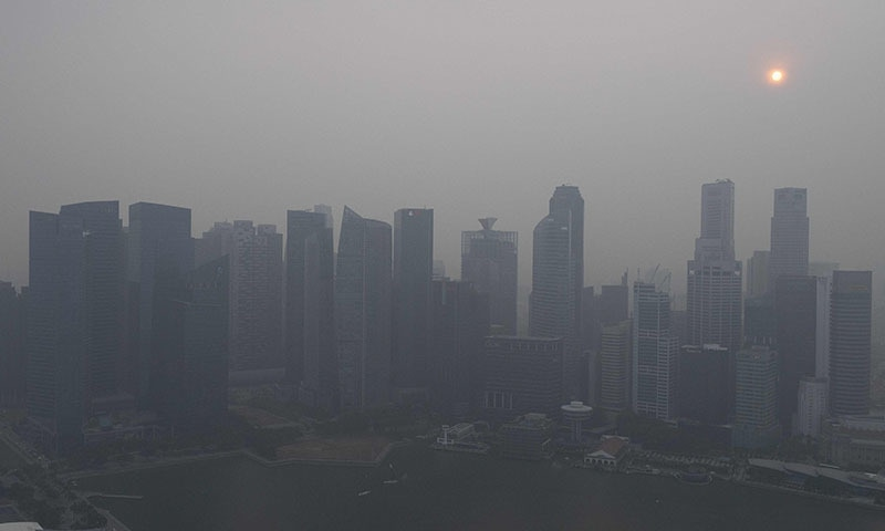 Buildings are seen as haze blankets the skyline of Singapore on September 18. — AFP