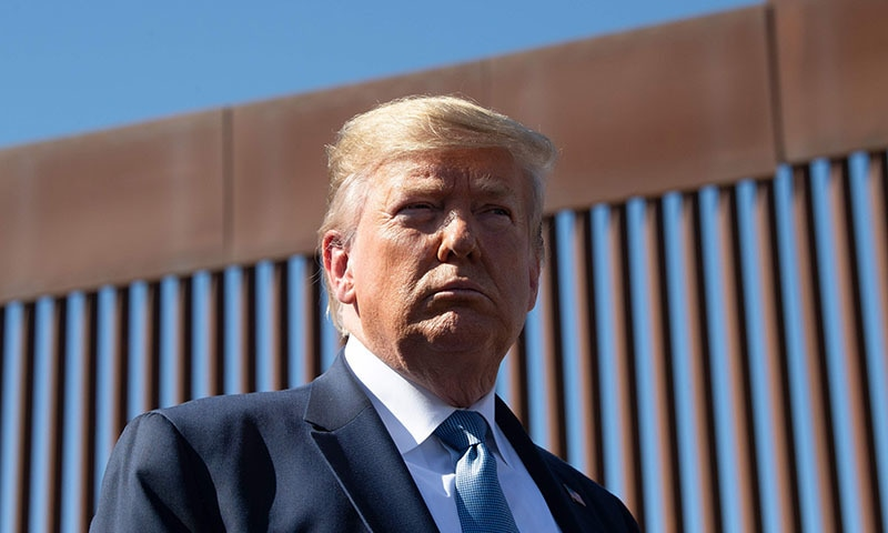 US President Donald Trump visits the US-Mexico border fence in Otay Mesa, California on September 18. — AFP