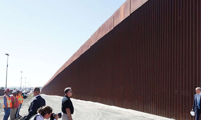 US President Donald Trump visits a section of the US-Mexico border wall in Otay Mesa, California, US on September 18. — Reuters