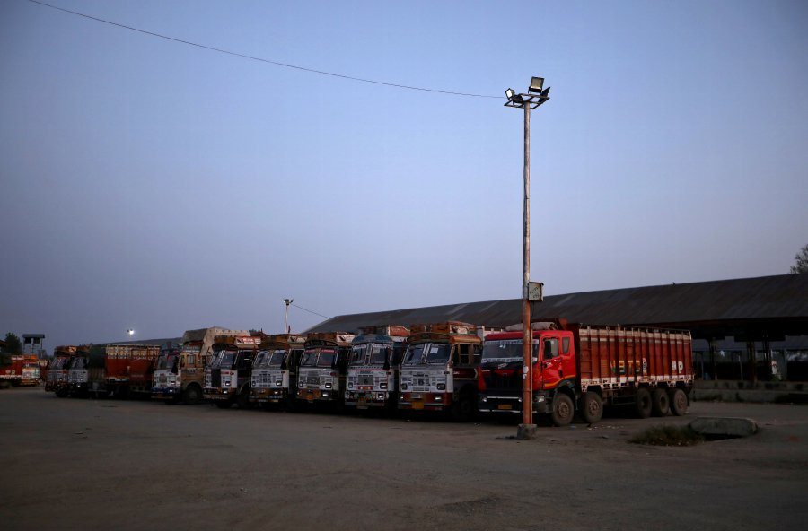 Supply trucks are seen parked inside empty Mustafa Memorial Fruit Mandi, a wholesale fruit market, in Sopore, north Kashmir. ─ Reuters