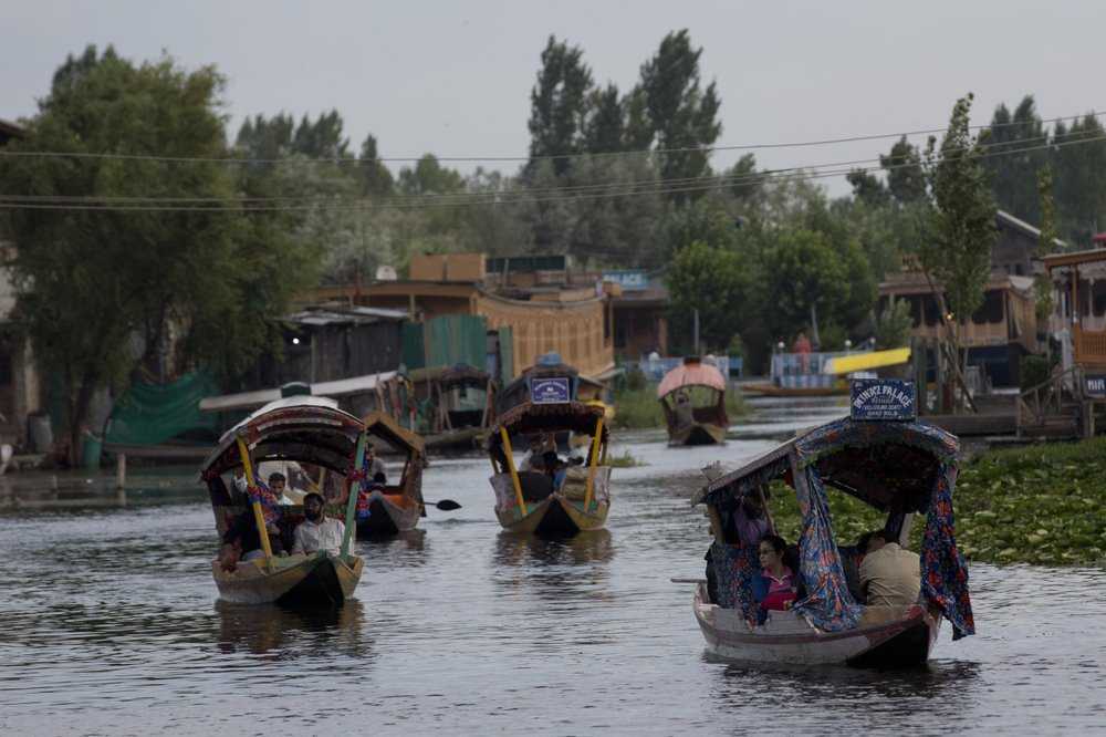 Tourists in Shikaras, a traditional gondola, cross the Dal Lake as they prepare to leave Srinagar on August 3, two days before India stripped Jammu and Kashmir of autonomy. ─ AP