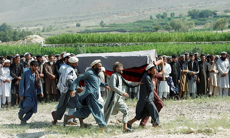 Men carry a coffin of one of the victims after a drone strike, in Khogyani district of Nangarhar province, Afghanistan on September 19. — Reuters