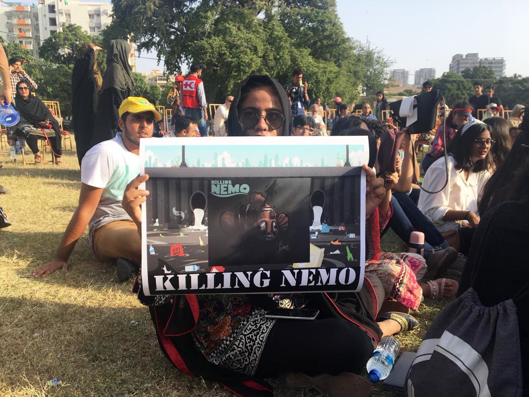 "A protestor in Karachi displays a sign ""Killing Nemo"" highlighting the menace of sea pollution that has swept the globe. — Sana Ali"
