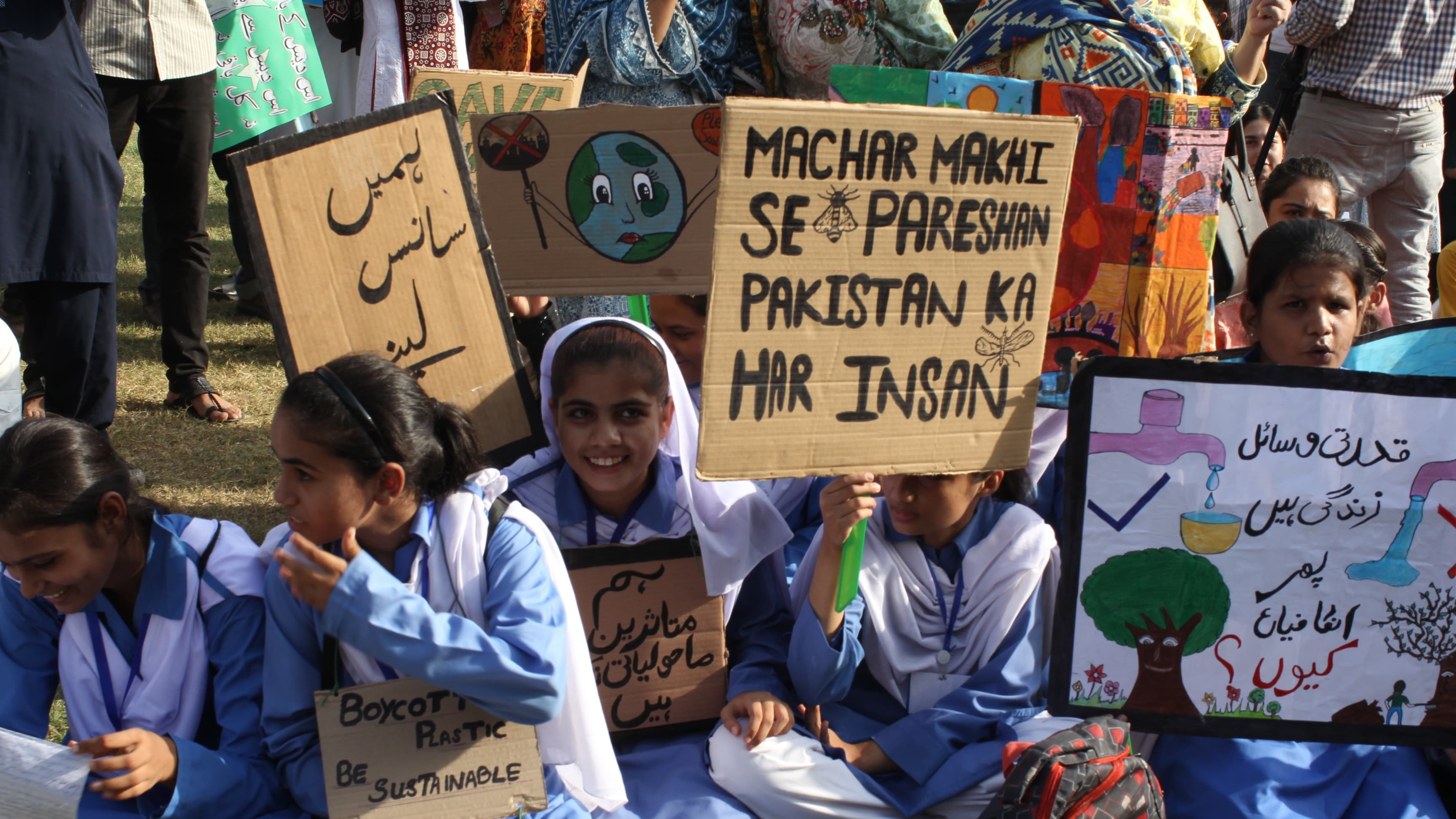 Students at the climate march in Karachi on Friday. — Photo by Kamran Nafees