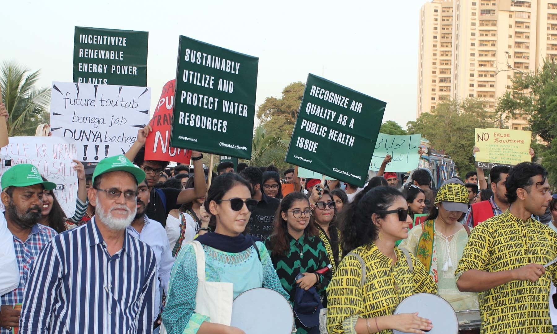 Attendees at the climate march in Karachi. — Photo by Kamran Nafees