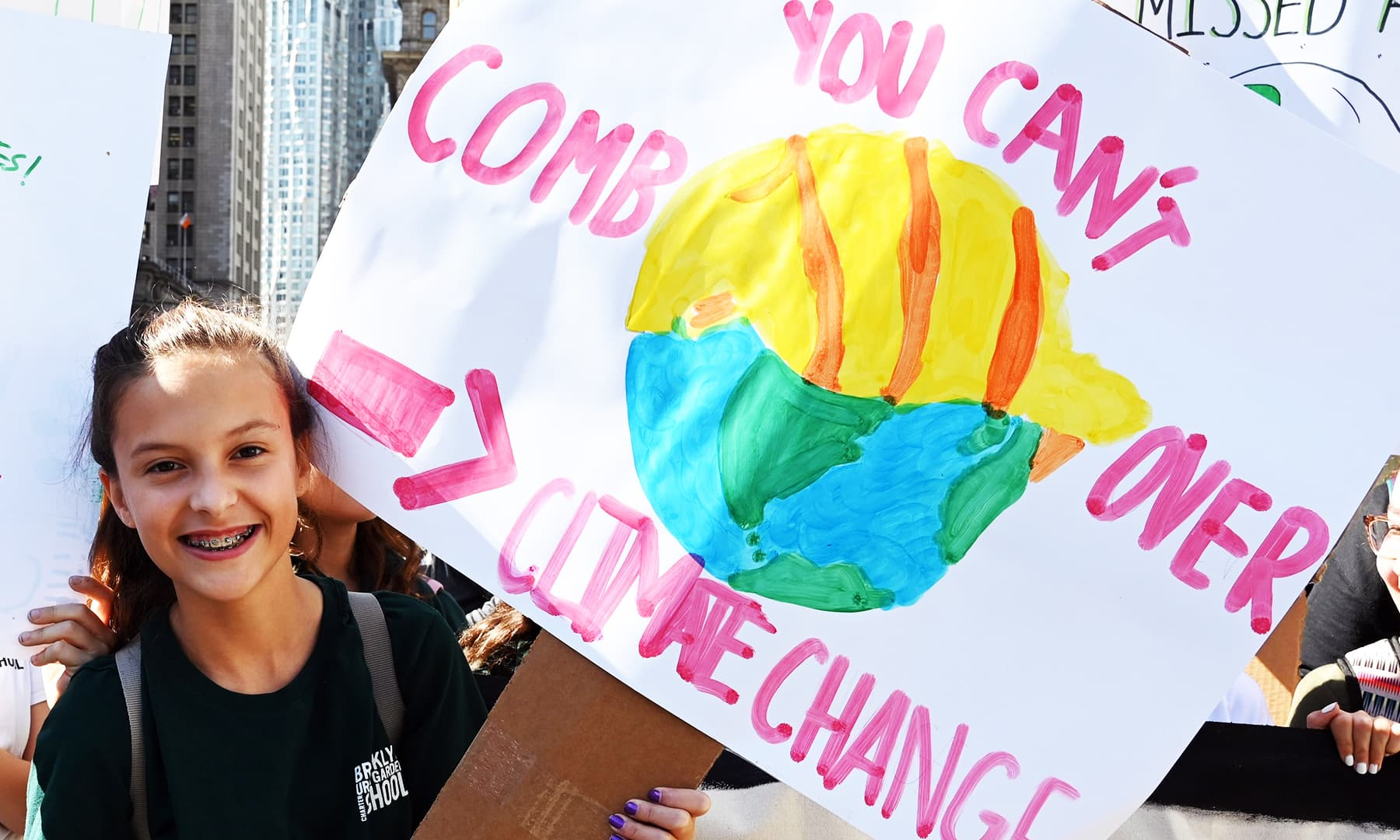 Another student holds up a sign during the Global Climate Strike march at Foley Square in New York.1 AFP