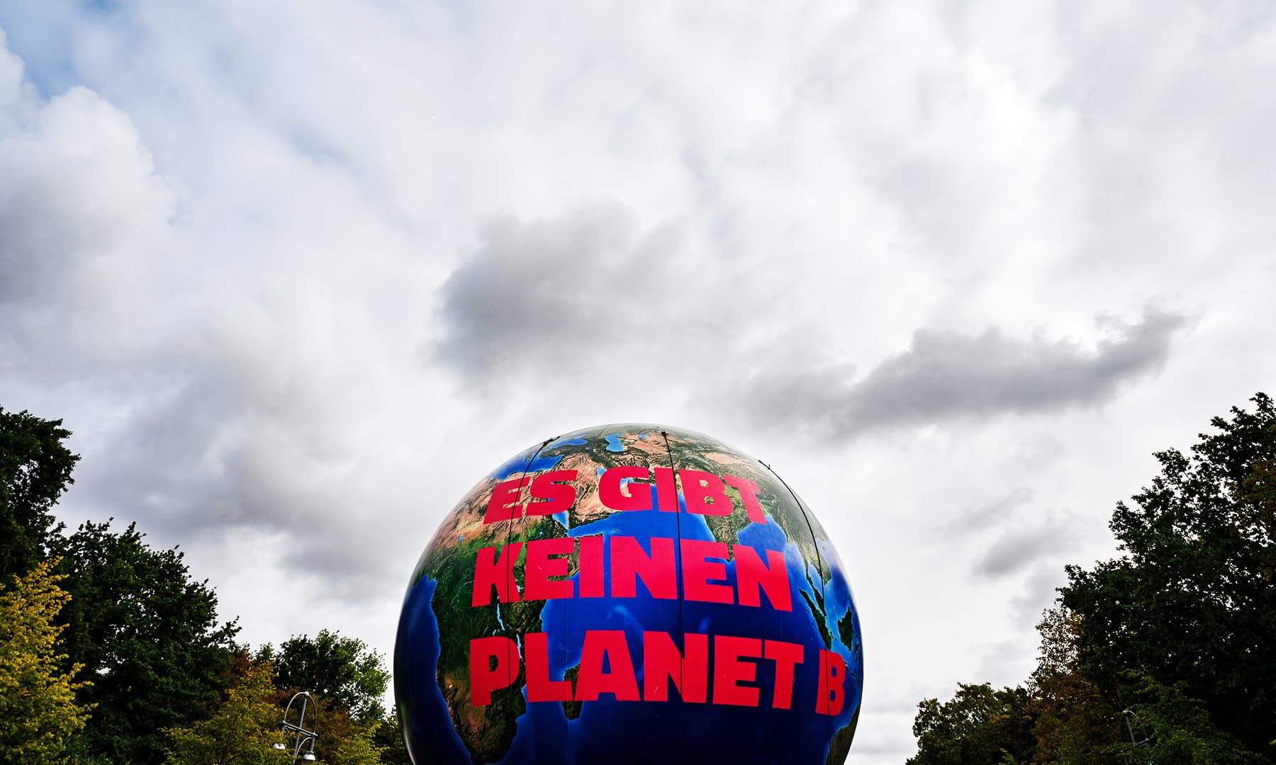 "Protesters carry a giant inflatable globe inscribed with the words: ""There is no planet B"" during a protest for climate action in Berlin.— AFP"