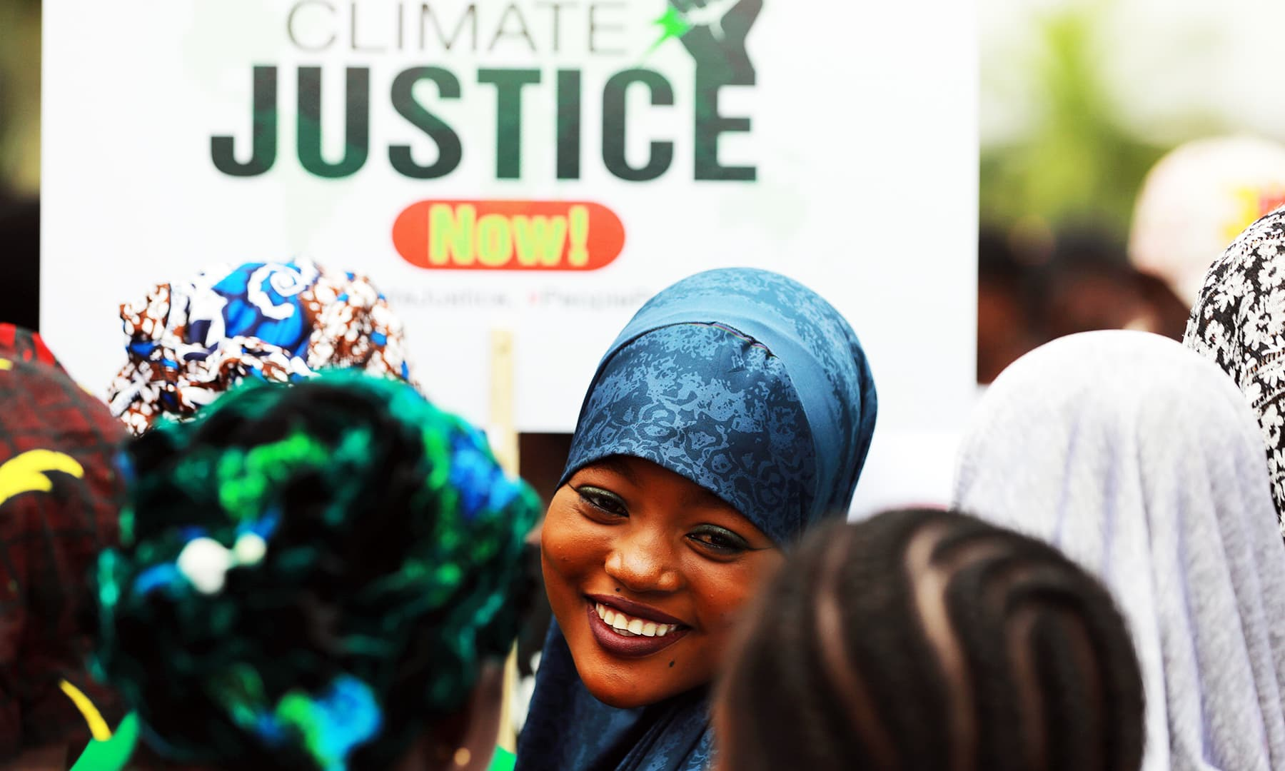 A protester smiles during a demonstration for climate protection in Abuja, Nigeria September 20, 2019. — Reuters