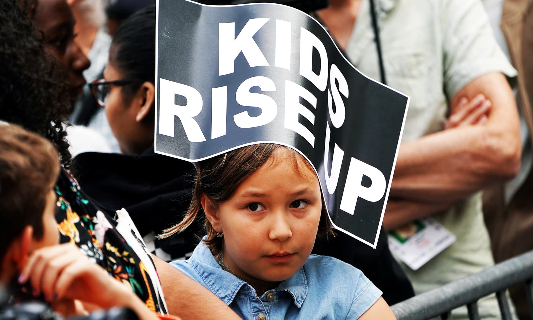 A child wears a sign as activists take part in a demonstration as part of the Global Climate Strike in lower Manhattan in New York.— Reuters