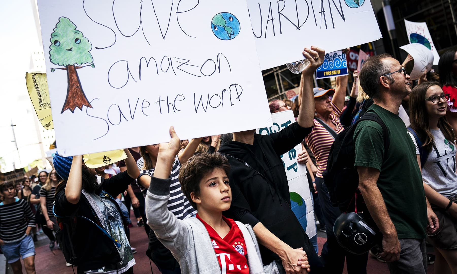 Young activists and their supporters rally for action on climate change in New York City. — AFP
