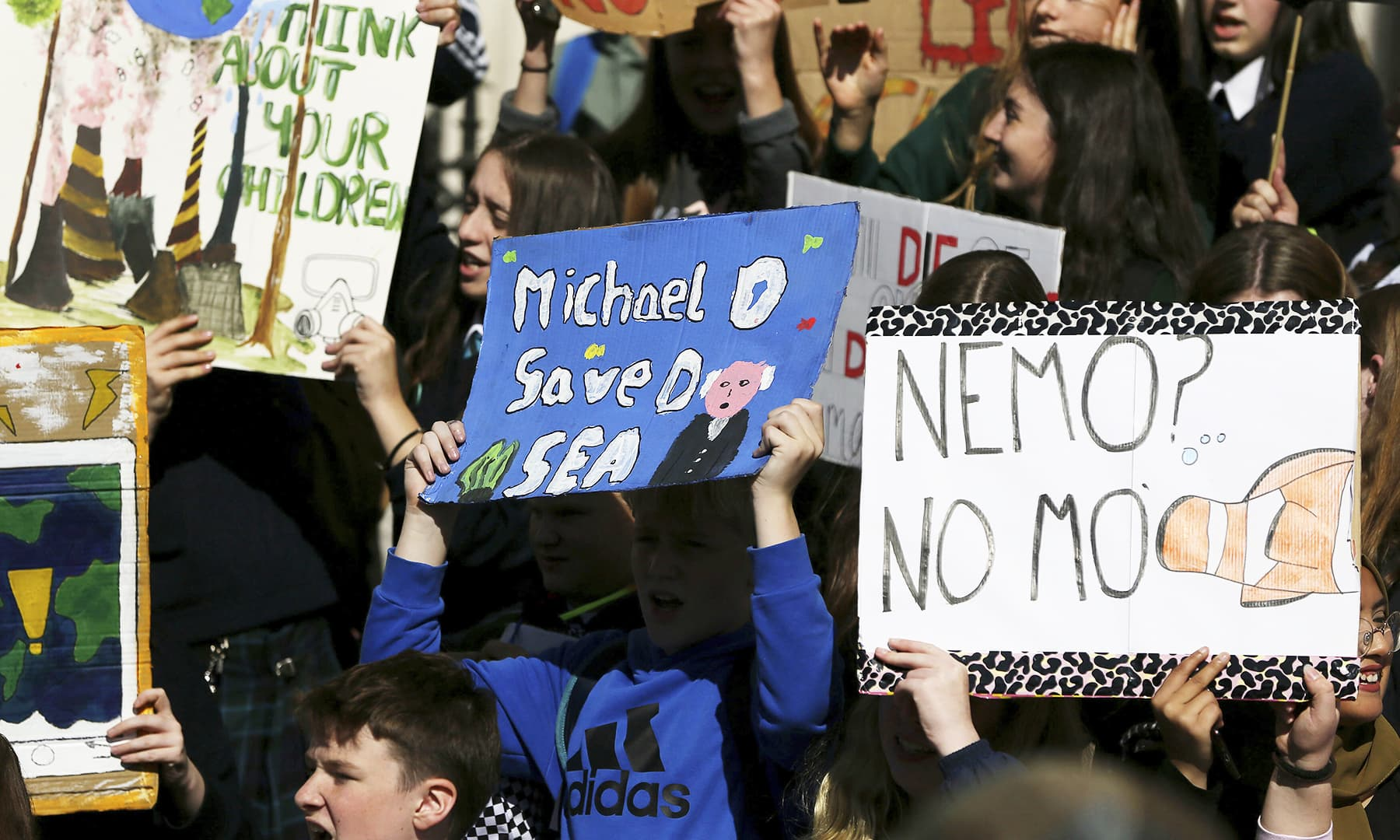 Students hold banners during a climate protest in Dublin, Friday, Sept. 20, 2019. — AP