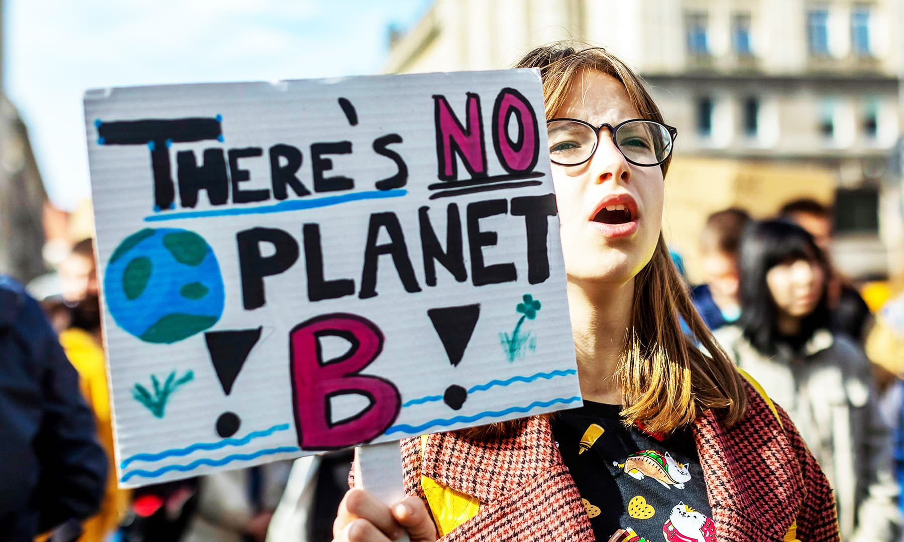 A young demonstrator holds a placard reading 'There's no planet B' as she takes part in a 'Fridays For Future' demonstration calling for climate action in the streets of Warsaw.— AFP/File