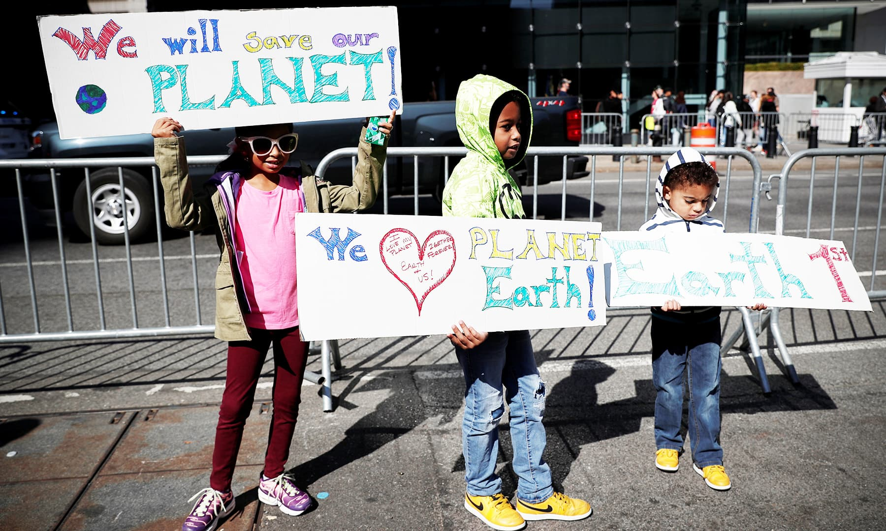 Children hold signs as they take part in a demonstration as part of the Global Climate Strike in Manhattan in New York. — Reuters