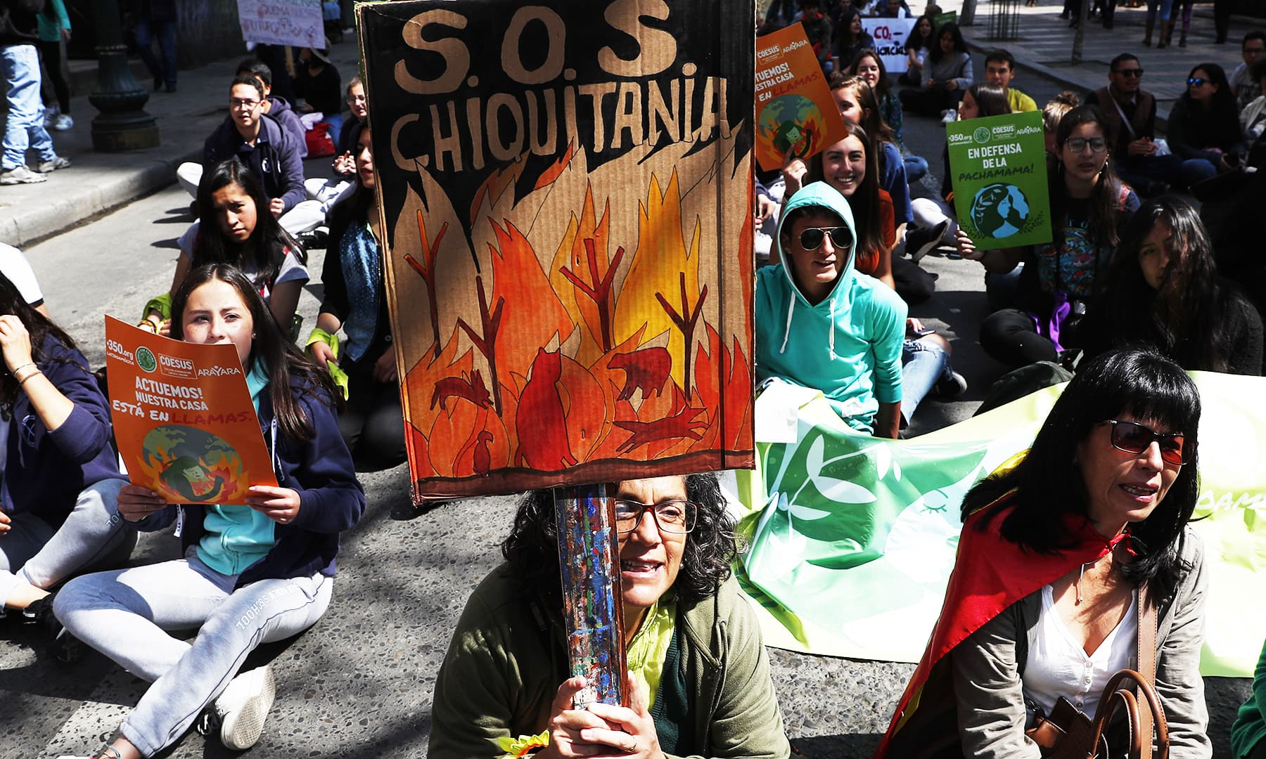 A woman chants slogans against the recent forest fires, during a global protest on climate change in La Paz, Bolivia.— AP