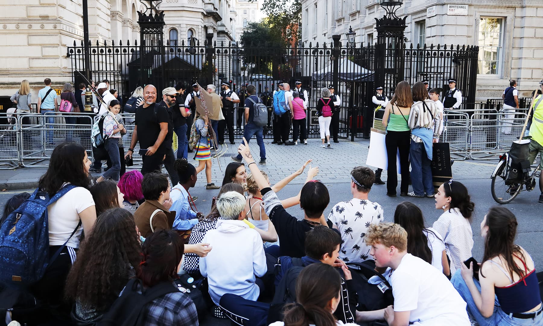 Climate protesters demonstrate in front of the gate to Downing Street in London.— AP