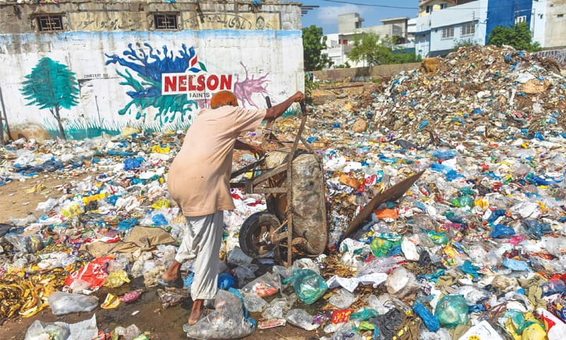THE CM and his team have their work cut out for them, as seen in this file photo of a garbage dump in Liaquatabad.—White Star