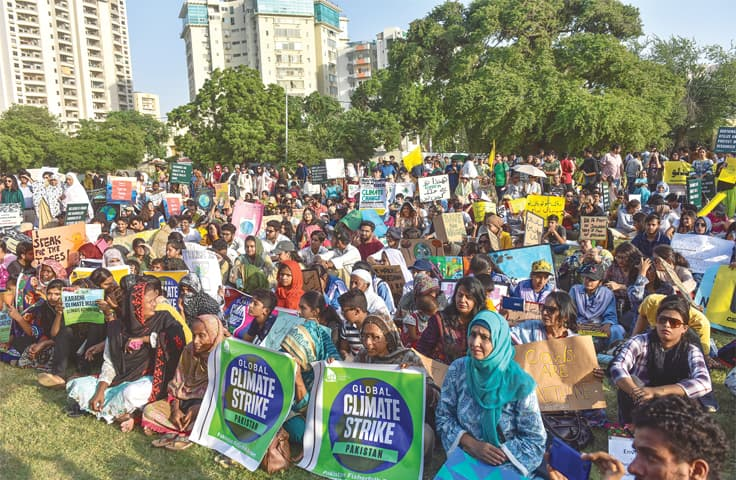People gathered at Frere Hall for the Climate March on Friday listen to speeches highlighting environmental challenges.—Fahim Siddiqi / White Star