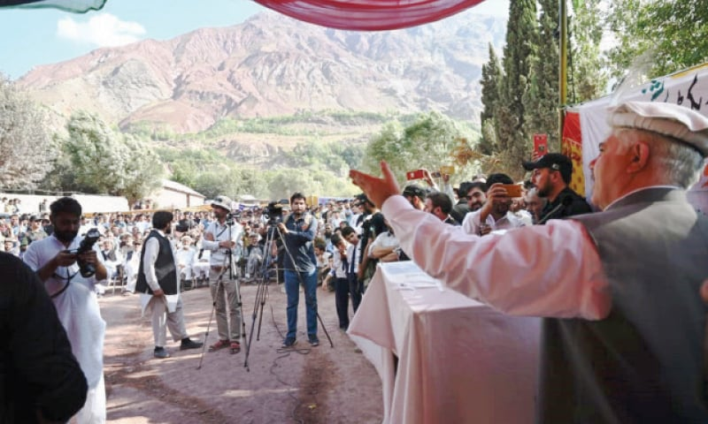 KP Chief Minister Mahmood Khan addresses a public gathering in Reshun area of Chitral on Friday. — Dawn