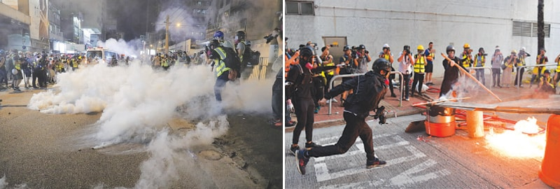 HONG KONG: A protester throws a molotov cocktail (right) during clashes with police on Saturday. Police fire tear gas (left) in a street to deter the protesters from proceeding further.—Agencies
