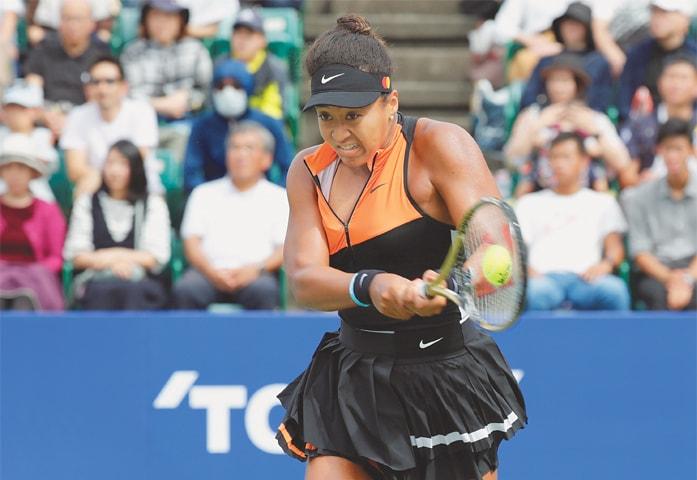 OSAKA: Japan's Naomi Osaka hits a return to Anastasia Pavlyuchenkova of Russia during the Pan Pacific Open final at the Utsubo Tennis Center on Sunday.—Reuters