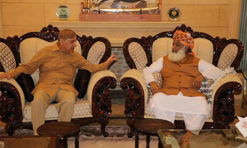 Jamiat Ulema-i-Islam-Fazl (JUI-F) chief Maulana Fazlur Rehman called on PML-N president and Opposition Leader in National Assembly Shahbaz Sharif on Sunday and discussed modalities for the proposed long march against the government. — Photo by Javed Hussain/File