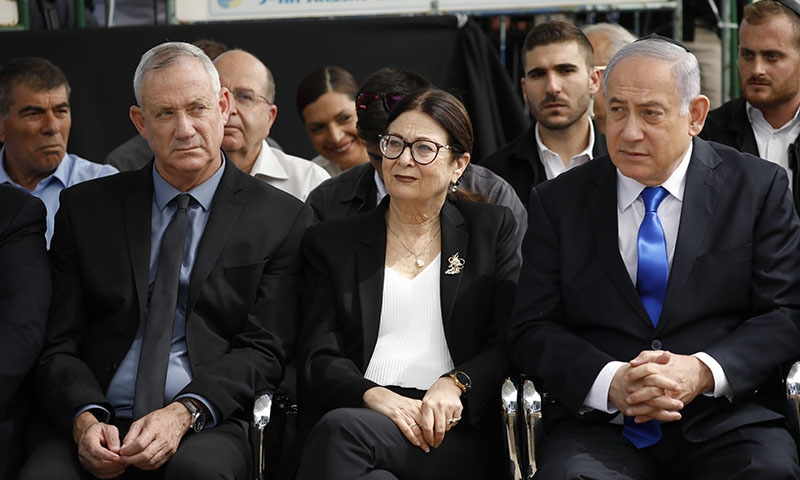 In this September 19 file photo, Blue and White party leader Benny Gantz, left, Esther Hayut, the Chief Justice of the Supreme Court of Israel, and Prime Minister Benjamin Netanyahu attend a memorial service for former President Shimon Peres in Jerusalem. — AP