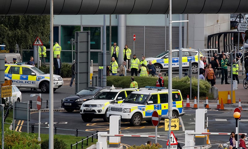Police officers are seen as a suspect package was found at Manchester Airport, in Manchester, Britain September 23. — Reuters