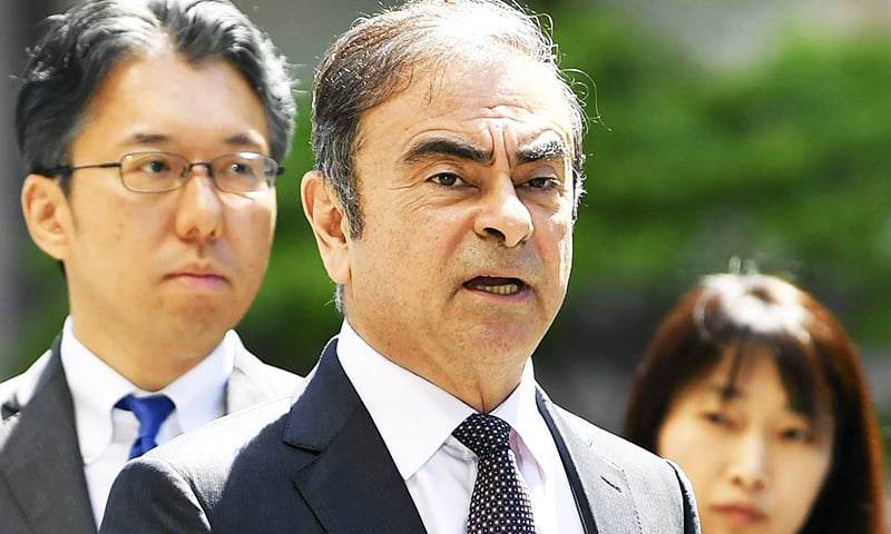 In this May 23, 2019, file photo former Nissan chairman Carlos Ghosn, center, arrives at Tokyo District Court for a pre-trial meeting in Tokyo. — AP