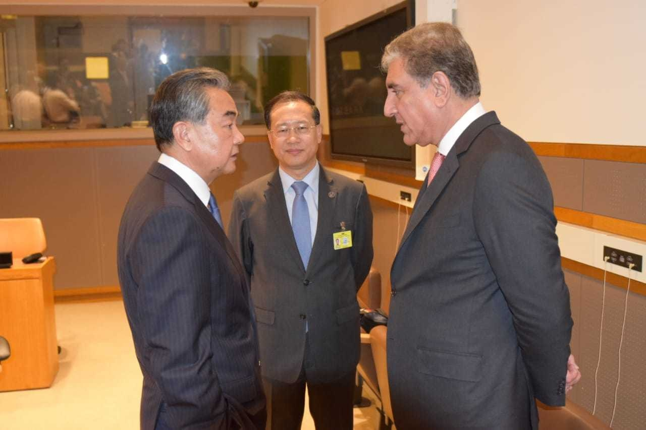 Foreign Minister Shah Mahmood Qureshi talking to his Chinese counterpart Wang Yi on Monday Sept 23, 2019. — Photo provided by author