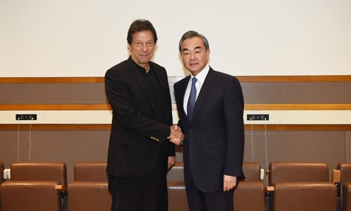 Chinese Foreign Minister Wang Yi and Prime Minister Imran Khan met in New York on Monday on the sidelines of the ongoing UN General Assembly session. — Photo via mfa.gov.cn
