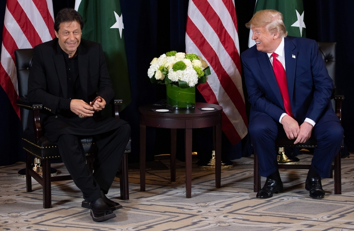 President Donald Trump and Prime Minister Imran Khan meet in New York on Monday. ─ AFP