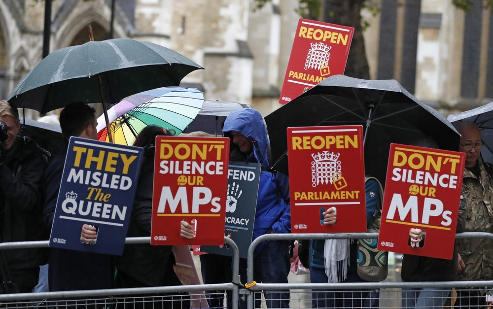 Anti-Brexit supporters gather in the rain outside the Supreme Court in London on Tuesday. — AP