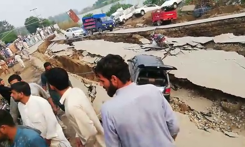 A road heavily damaged by the quake in Mirpur. — DawnNewsTV