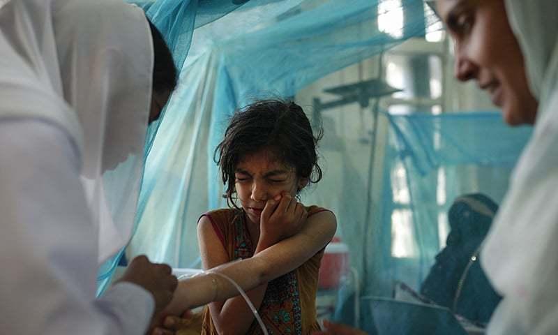 A child is examined at the dengue ward at the Benazir Bhutto Hospital, Rawalpinidi – Photo: Sara Farid