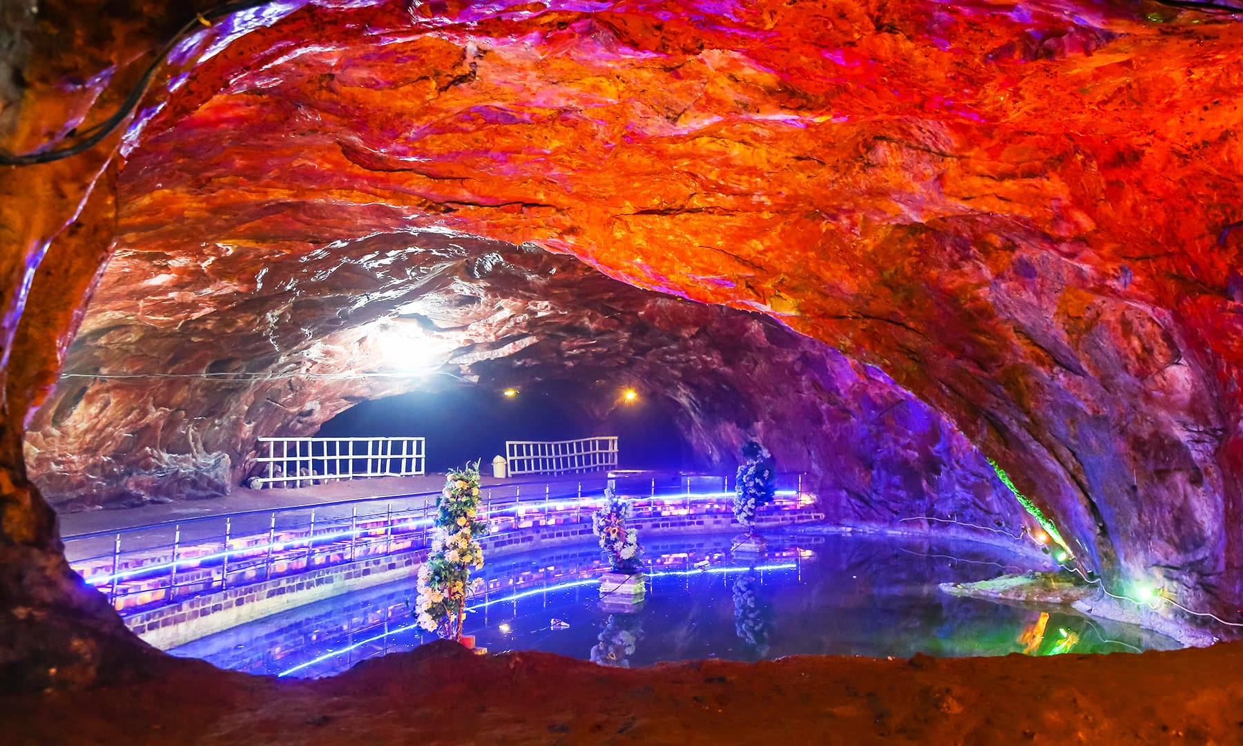 View of the beautiful pond with Christmas trees inside the Khewra Salt Mines.
