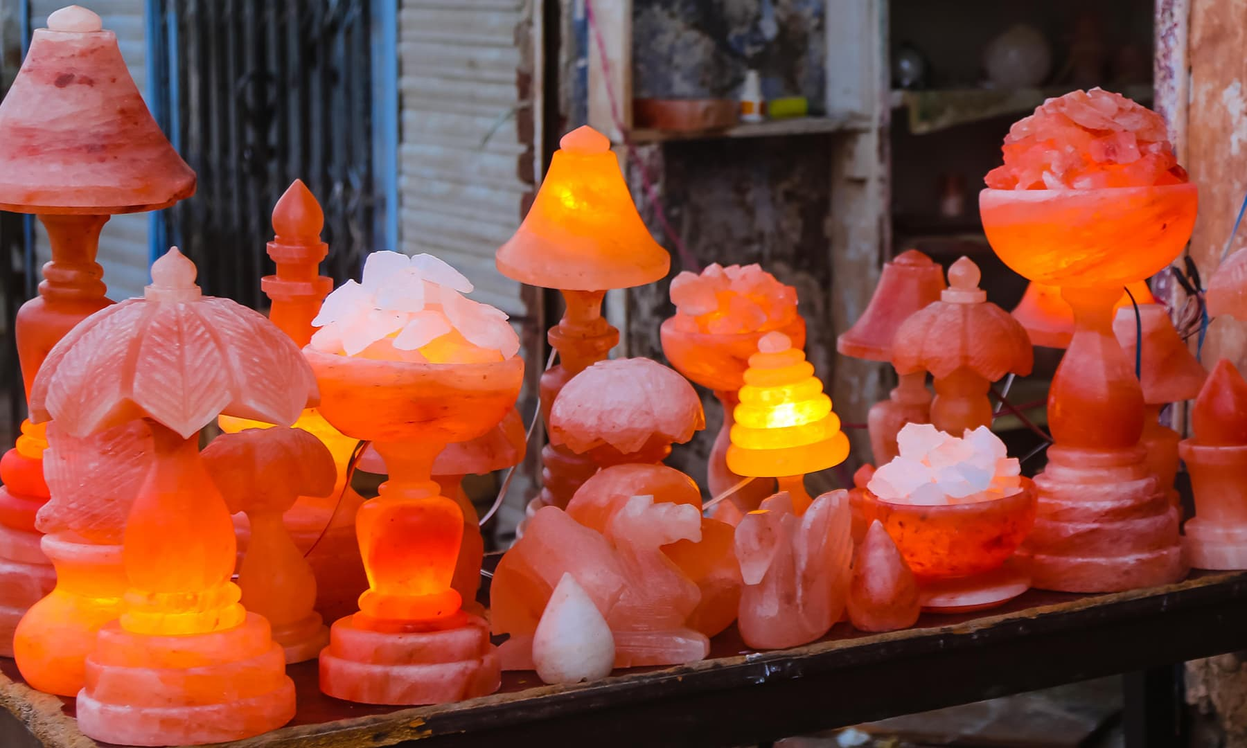 Close up of glowing souvenirs on display for sale.