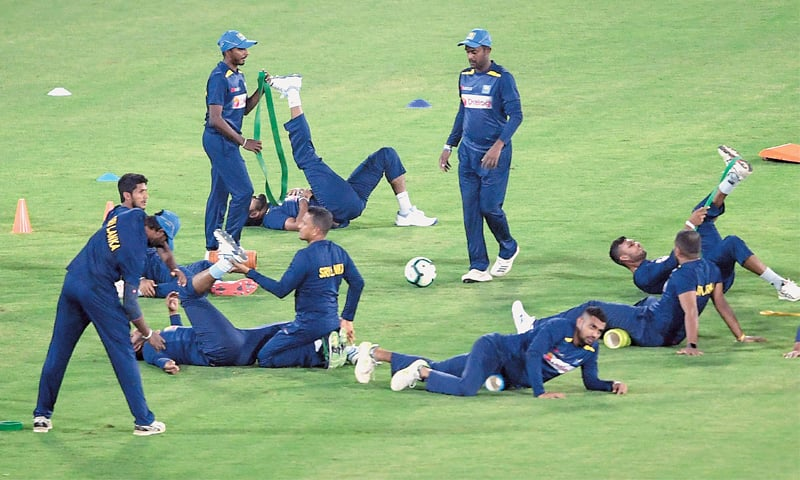 SRI LANKAN players warm up before a practice session on Thursday.—AFP