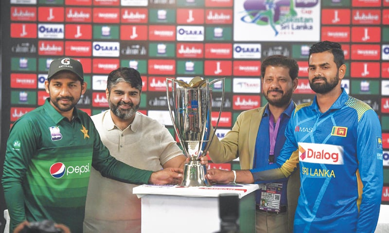 Pakistan captain Sarfaraz Ahmed holds the ODI trophy along with Sri Lanka's captain Lahiru Thirimanne during a ceremony at the National Stadiumin Karachi on Thursday. Karachi hosts a one-day international for the first time in 10 years when Pakistan take on Sri Lanka on Friday, furthering the revival of international cricket in the country.—AFP