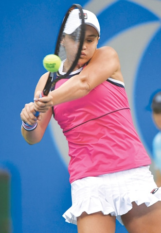 WUHAN: Ashleigh Barty of Australia hits a return to Belarus' Aryna Sabalenka during their semi-final at the Wuhan Open on Friday.—AFP