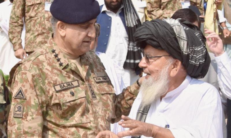 Chief of the Army Staff Gen Qamar Javed Bajwa speaks to a tribal elder in Miramshah.