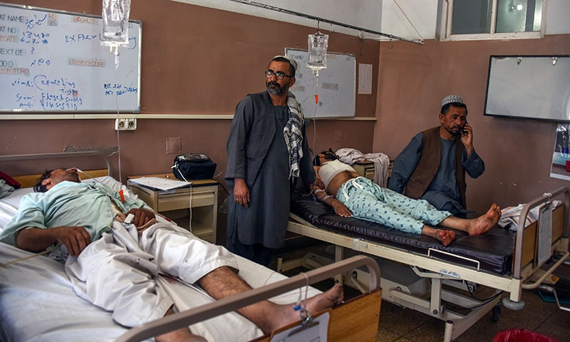Wounded men receive treatment at a hospital following a blast in Kandahar Province on Sept 28. — AFP