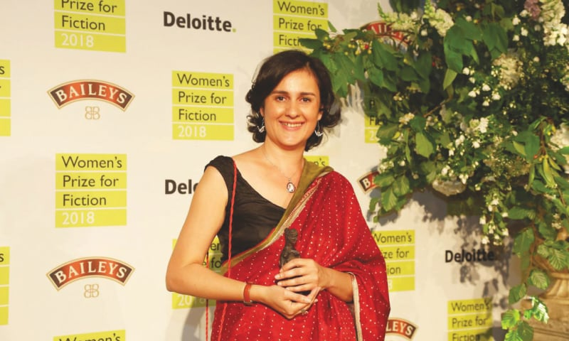 Kamila Shamsie at the Women's Prize for Fiction — one of the United Kingdom's most prestigious literary awards — ceremony with 'Bessie', the bronze statuette presented to winners along with a cash award | Penguin Random House