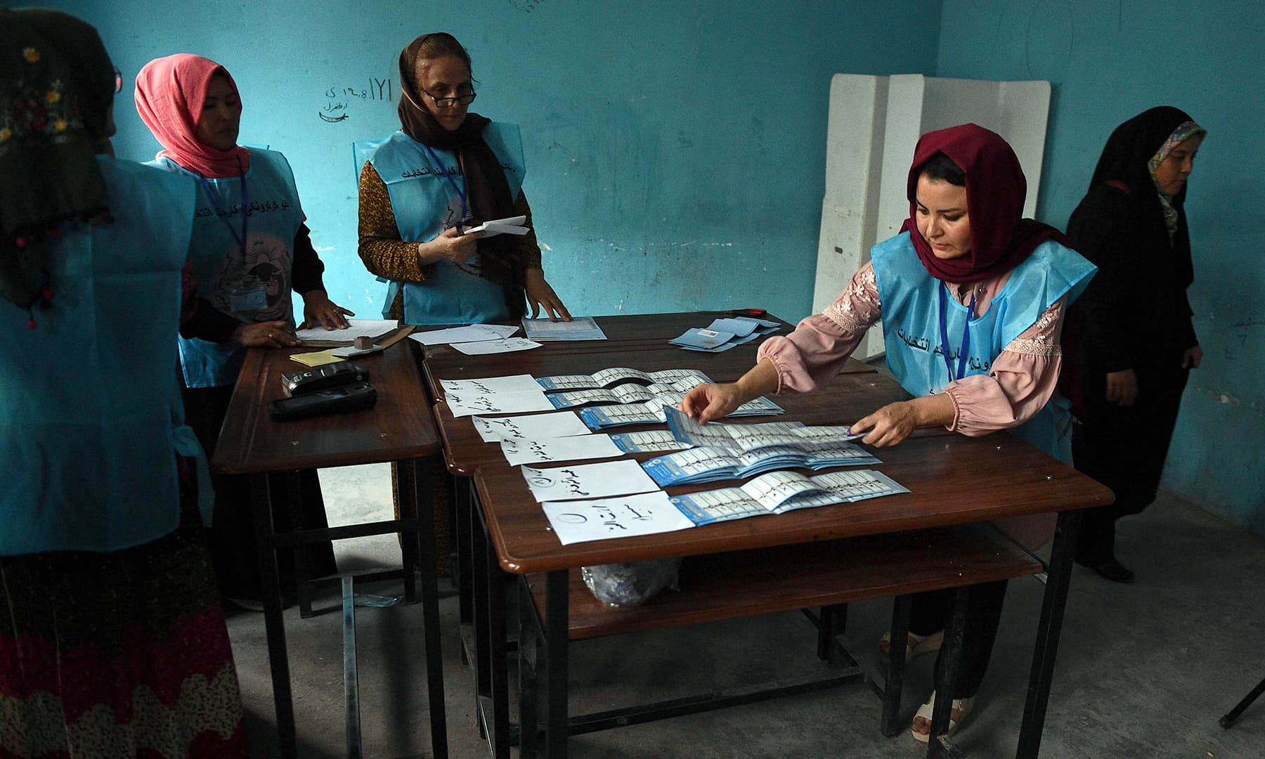 Afghan Independent Election Commission (IEC) officials count ballot papers after polling stations closed, in Mazar-i- Sharif. — AFP