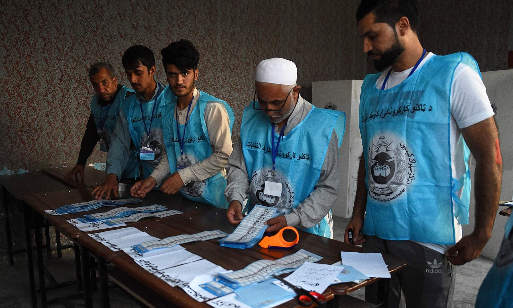 Afghan Independent Election Commission (IEC) officials count ballot papers after the polling station was closed, in Mazar-i-Sharif. — AFP